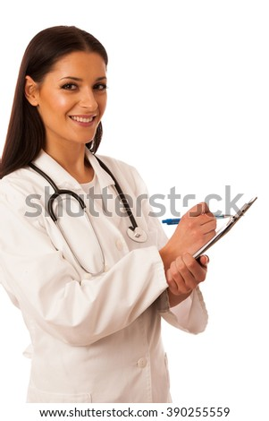 Woman doctor with stethoscope around neck writing diagnose on clipboard.