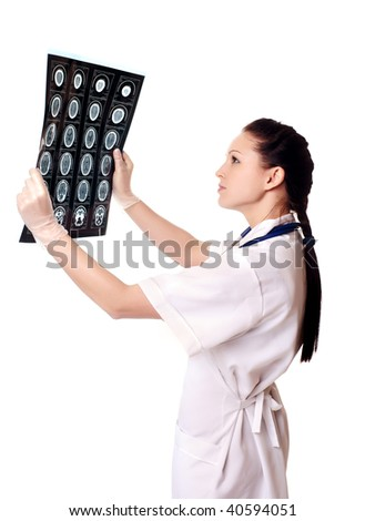 woman doctor with x-rays of brain - stock photo