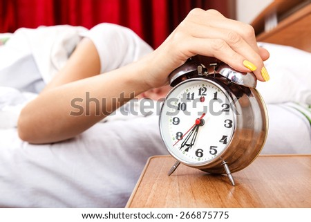 Woman does not want to wake up - stock photo