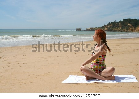 woman does yoga and meditation on beach