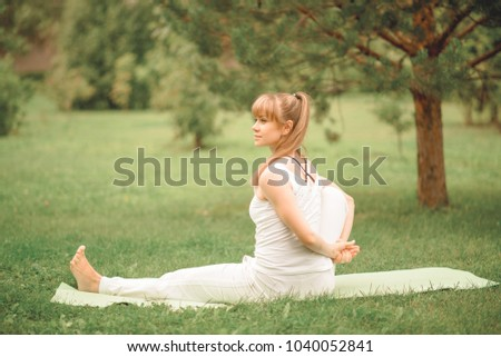 woman does Yoga in the park