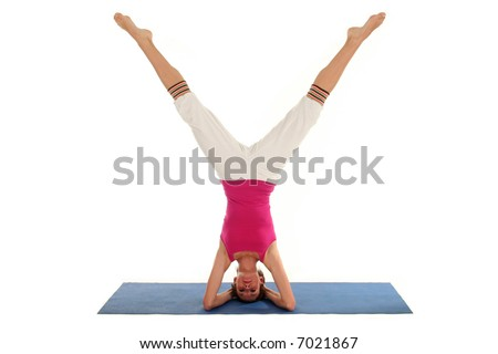 Woman Doing A Headstand On A Yoga Mat - stock photo