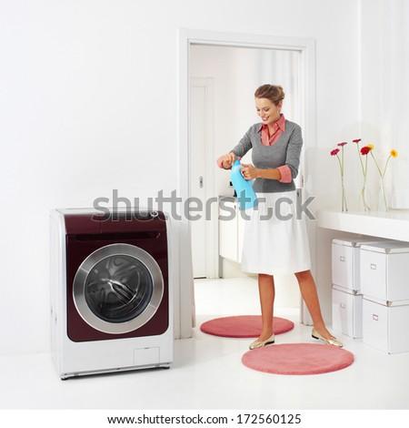 woman doing a housework holding presoak  - stock photo