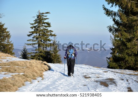 Woman doing a winter hiking in the snow