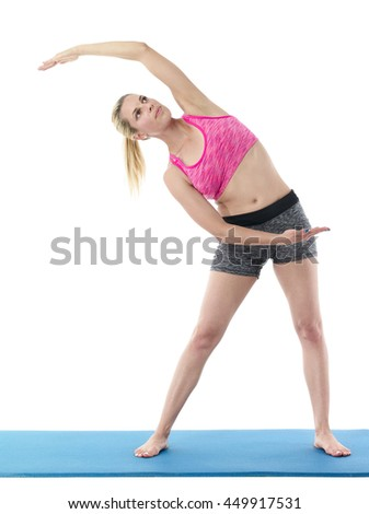 Woman doing  abdominal  and belt muscles stretching exercises isolated on a white background.