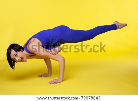 woman doing arm balance yoga and fall