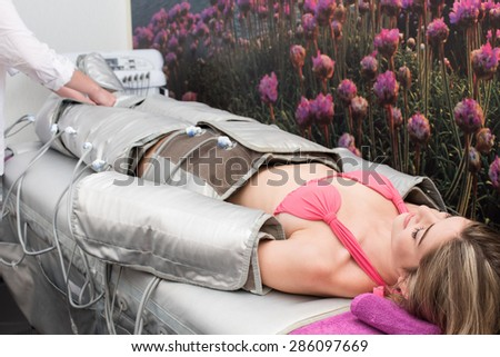 Woman doing cosmetic procedures in spa clinic