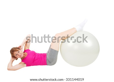 Woman doing crunches with a fitness ball - stock photo