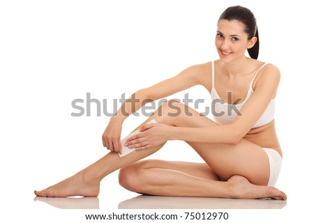 woman doing depilation on her legs with waxing, isolated on white - stock photo