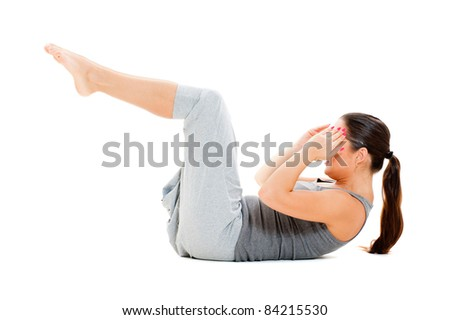 woman doing exercises for abdominal muscles. isolated on whit? background - stock photo
