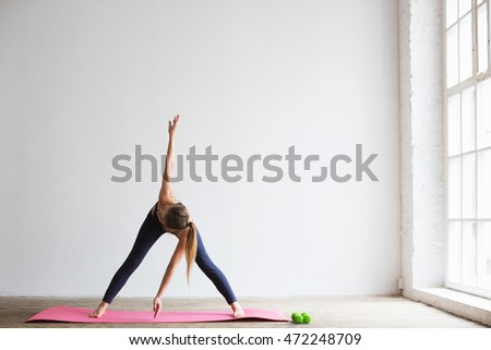 Woman doing fitness exercise, at home.