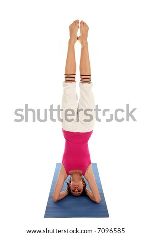Woman doing headstand - stock photo