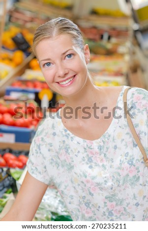 Woman doing her weekly shop - stock photo