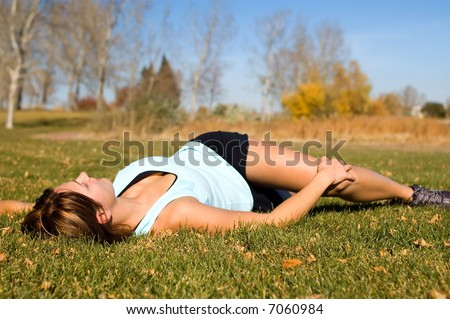 Woman doing lower back laying down Stretch.