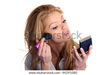 woman doing makeup in the morning in bed - stock photo