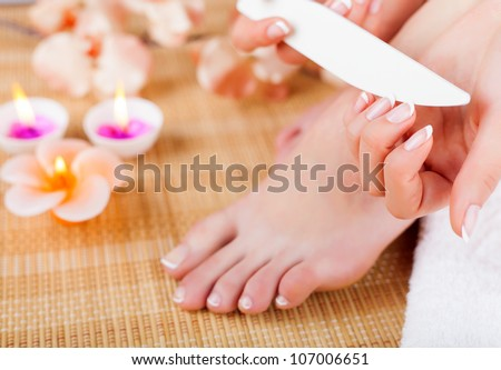 Woman doing manicures and pedicures. Close-up - stock photo