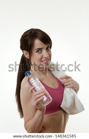 woman doing or just done a work out with a white towel around her neck - stock photo