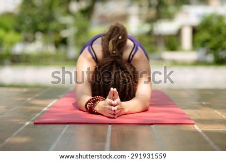 Woman doing pilates outdoors, selective focus - stock photo