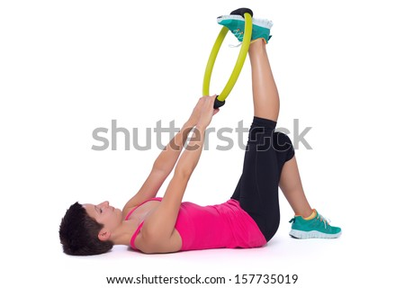 Woman doing pilates ring workout - stock photo