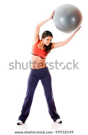 Woman doing pilates with a Swiss ball - isolated over a white background - stock photo