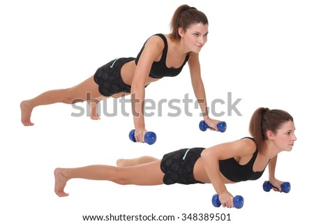 woman doing push-ups on dumbbells
