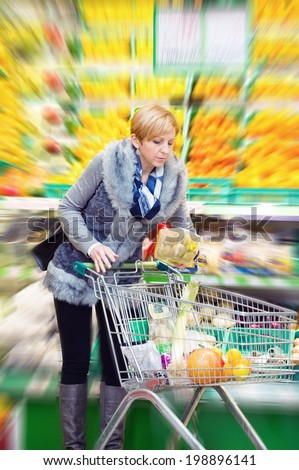 woman doing shopping in a supermarket