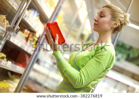 Woman doing shopping of merchandise in supermarket.Horizontal shot.  - stock photo