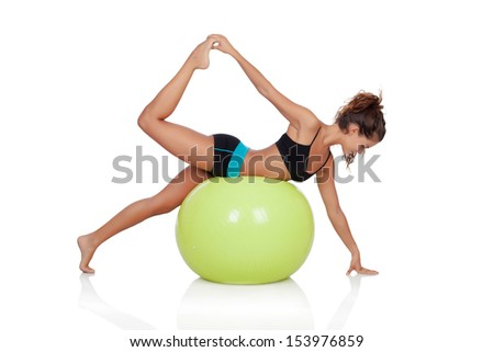Woman doing sports with a ball isolated on white background - stock photo
