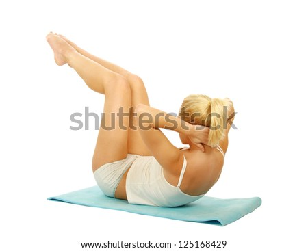 Woman doing strength exercises for abdominal muscles, isolated on white background - stock photo