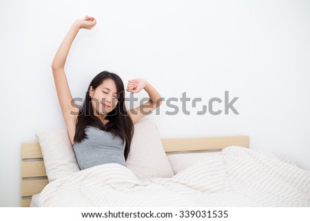 Woman doing stretching after just wake up - stock photo