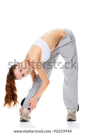 Woman doing stretching exercise and smiling to you, isolated on white background - stock photo