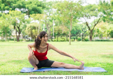 Woman doing stretching exercise in the park