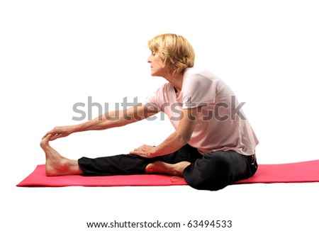 Woman doing stretching on a mat - stock photo