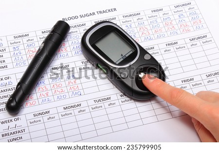 Woman doing test for determination level sugar, medical form with results of measurement of sugar, concept for diabetes - stock photo