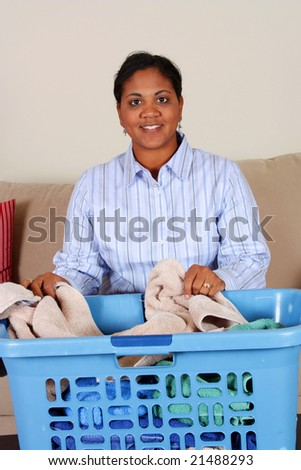 Woman doing the laundry in her home - stock photo