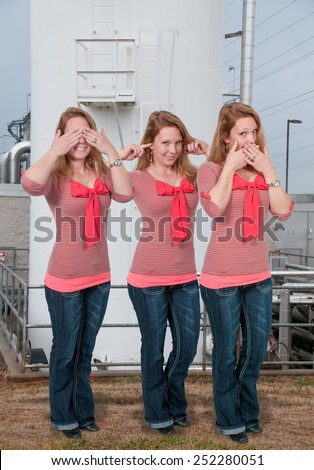 Woman doing the tradition see no evil hear no evil speak no evil gesture - stock photo