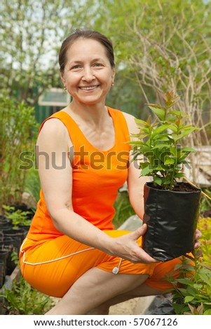 woman doing work in her garden with sprouts