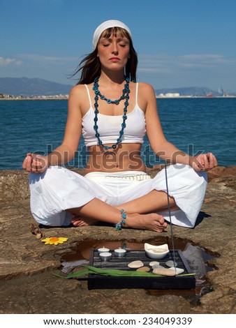 Woman doing yoga at the beach     - stock photo