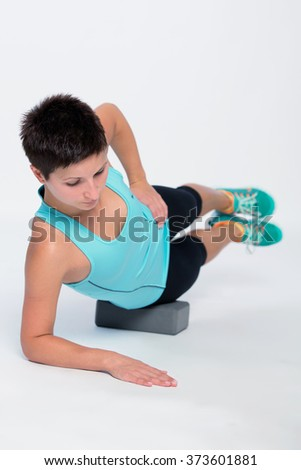 Woman doing yoga brick position