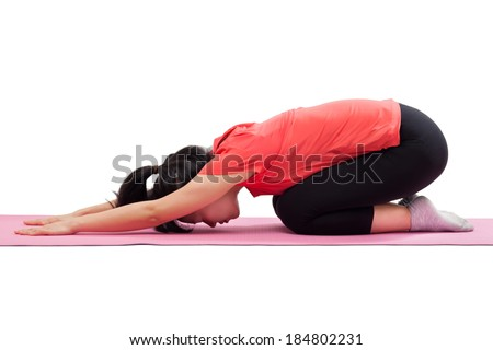 Woman doing yoga child pose isolated on white background - stock photo