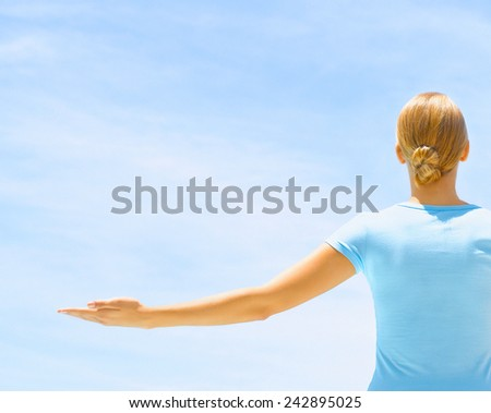Woman doing yoga exercise at poolside - stock photo