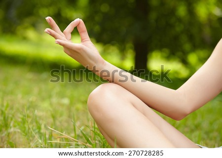 woman doing yoga exercises in the park - stock photo