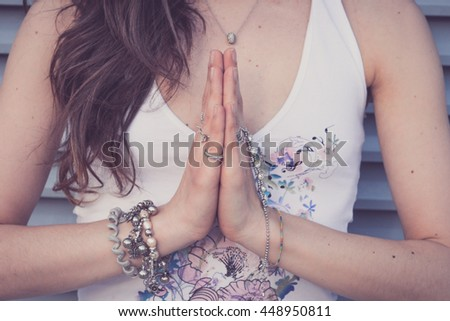 Woman doing yoga exercises outdoors in the city.Beautiful brunette fit young woman practicing yoga urban style. Anjali mudra salutation seal, sport, training and lifestyle concept - stock photo