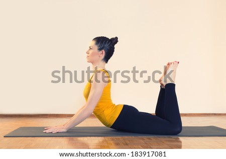 Woman doing yoga indoors. - stock photo
