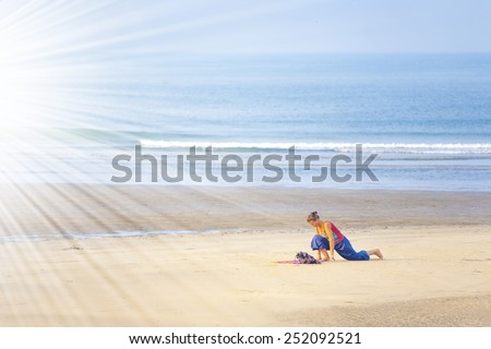 woman doing yoga on the beach. - stock photo