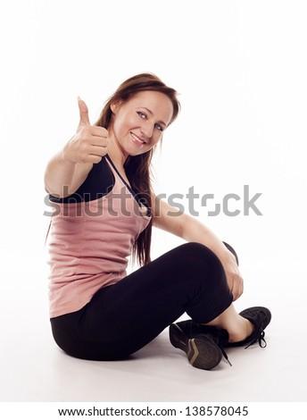 Woman doing yoga showing hand ok sign - stock photo