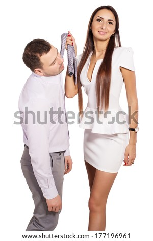 Woman dominates man at work. Woman demands an explanation for done with man. Female boss berates his subordinates. Interaction in the business team. Woman director and man slave. Working relationship. - stock photo