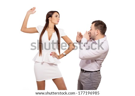 Woman dominates man. Female boss berates his subordinates. Interaction in the business team. Woman director and a man slave. The working relationship between a man and a woman. Isolated, white. - stock photo