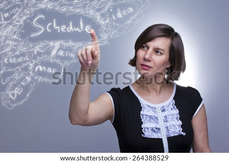 Woman drawing a future schedule by touching screen - stock photo