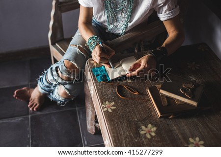 Woman drawing in sketchbook - stock photo